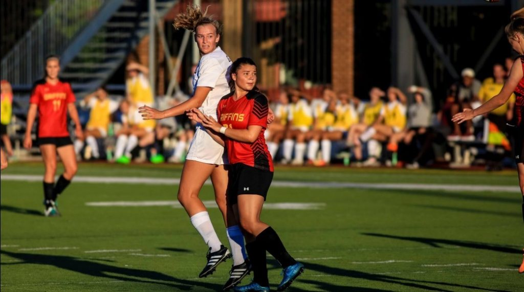Women's soccer scores late win