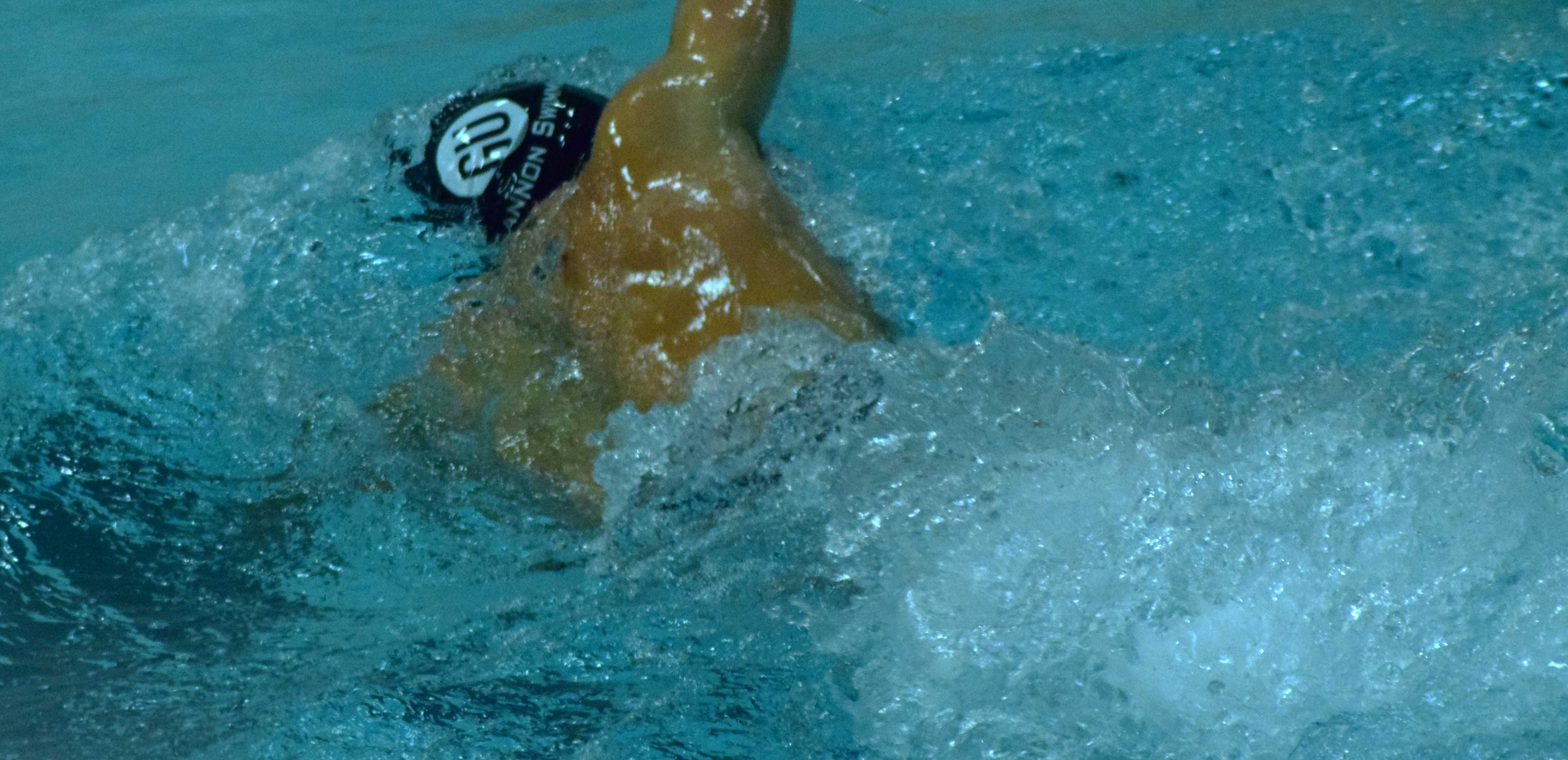 Men's, women's swim teams defeat John Carroll University