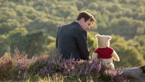 Christopher Robin. (Ewan McGregor) with his long time friend Winnie the Pooh in Disney's live-action adventure CHRISTOPHER ROBIN.