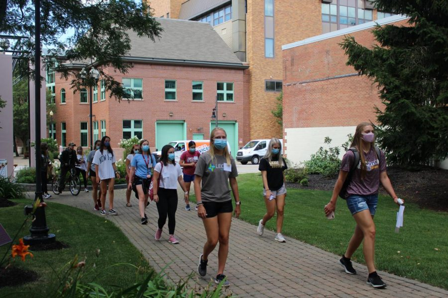 Incoming students follow a transition guide through A.J.s Way.