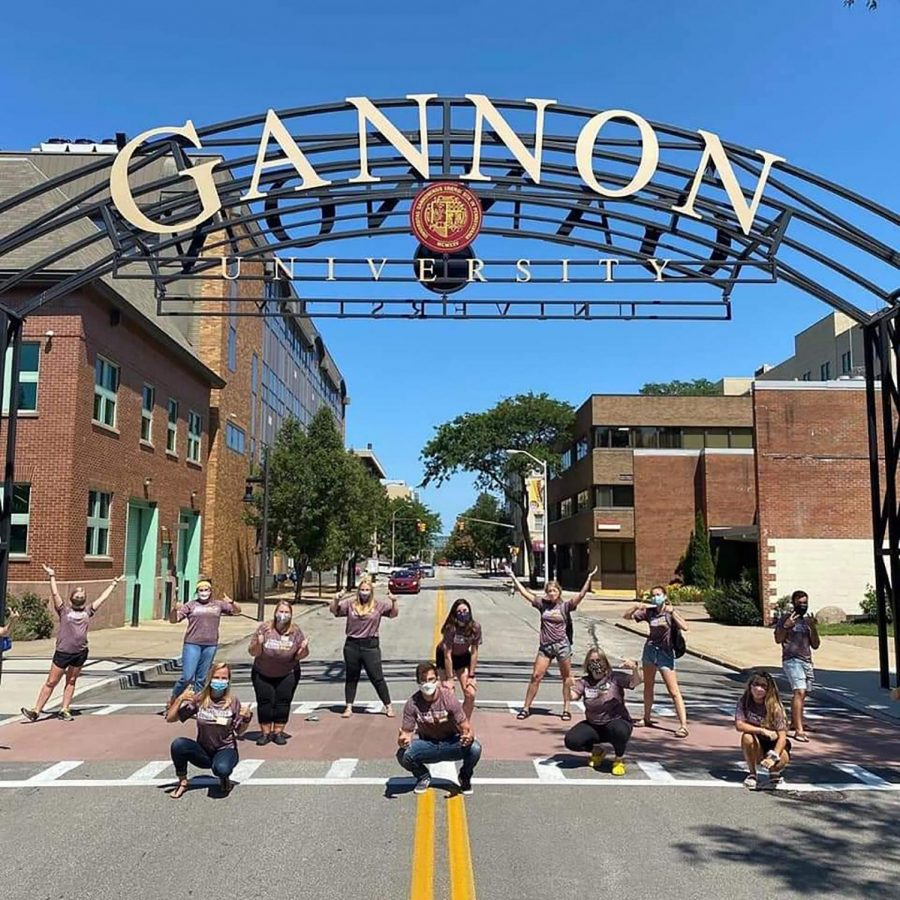 A group of students gather underneath the Gannon arch on West Seventh Street  practicing social distancing. Guidelines regarding social gatherings and distancing have been established for on-campus and off-campus housing in an effort to mitigate the spread of COVID-19.