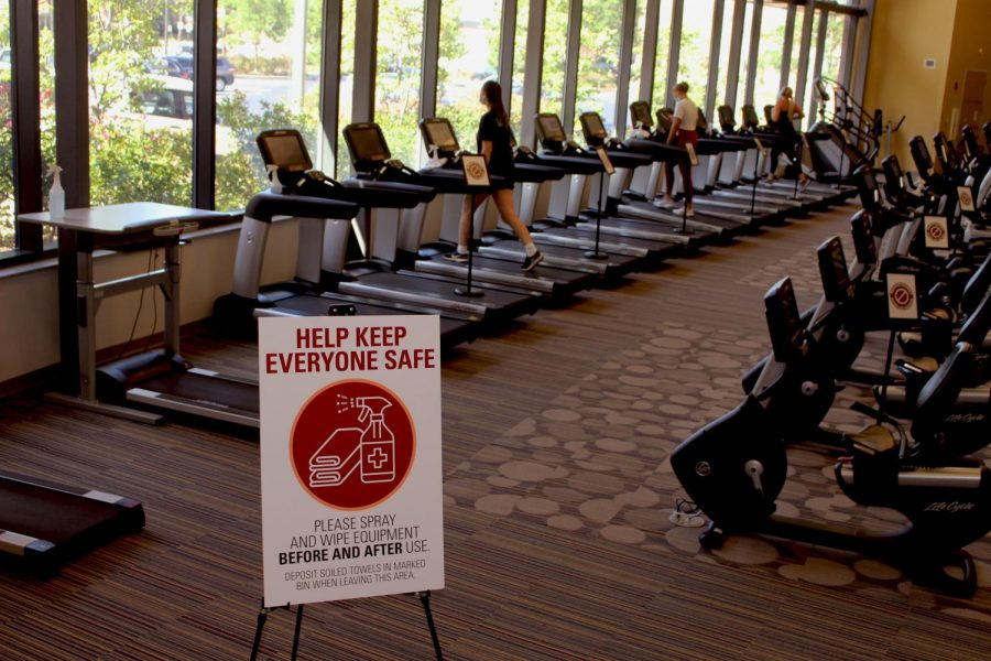 Students+utilize+the+treadmills+at+Gannon%E2%80%99s+Recreation+and+Wellness+Center.+Signs+are+in+place+at+the+RWC+to+ensure+people+maintain+proper+social+distance+and+disinfecting+procedures.+The+RWC+reopened+on+July+27+with+increased+COVID-19+protocols.