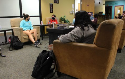 Sajita Elaprolu (front), Anna Ramalho (left) and Daniel Grabowski (center) sit in the commuter corner between classes, which has been greatly affected by the COVID-19 pandemic.