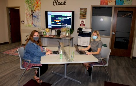 Alyssa Bileck, consultant supervisor at Gannon's Writing & Research Center, and Nicole Borro, assistant director, sit at a socially distanced table in the center, located in the lower level of the Nash Library. It is open Monday through Friday and Sunday nights.