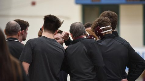 The Gannon University men's wrestling coach, Don Henry, meets with his team before competing during the 2019-20 season. The Knights would finish with an overall reocrd of 8-6.