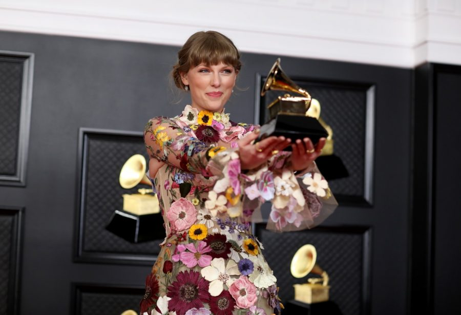 "TRIBUNE NEWS SERVICE  Swift holds Grammy for her album ""Folklore,"" proving her sound is timeless."