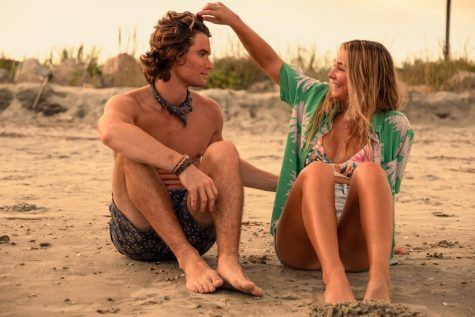 Main characters John B. and Sarah Cameron share a romantic moment on the sandy shore of the Outer Banks, into the second season of their romance.