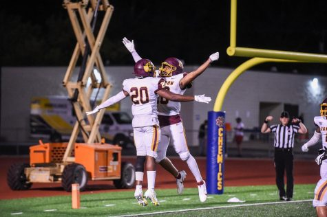 Wide receiver Sam East (20) celebrates with a teammate in end zone after a touchdown.
