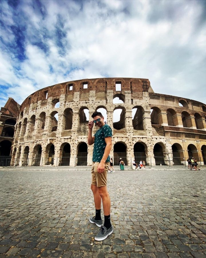 Grant Burnet outside of the Roman Colosseum during his semester in Rome.