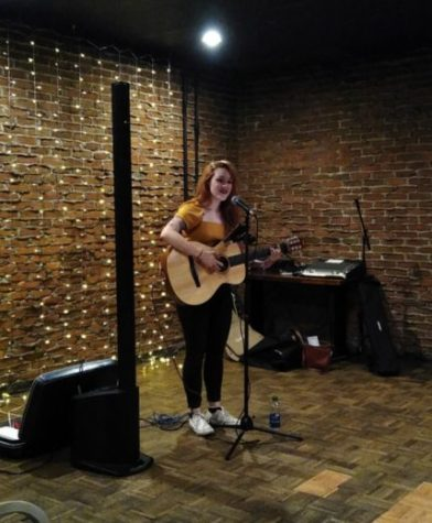 Gannon student participates in past karaoke night at The Knight Club.
