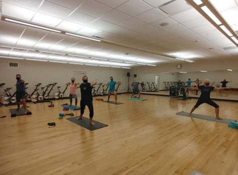 Taking a break from classes, students and faculty participate in yoga fitness class led by Terry on Tuesday at the Recreation and Wellness Center.